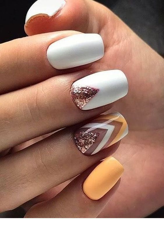 Light orange and white nail art