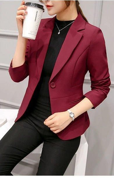 Black top and pants with a burgundy blazer