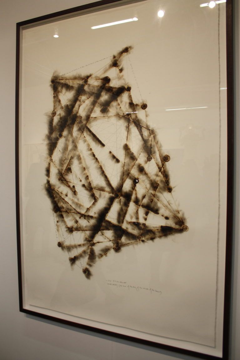 This work is composed of burnt adhesive and graphite on Arches paper.