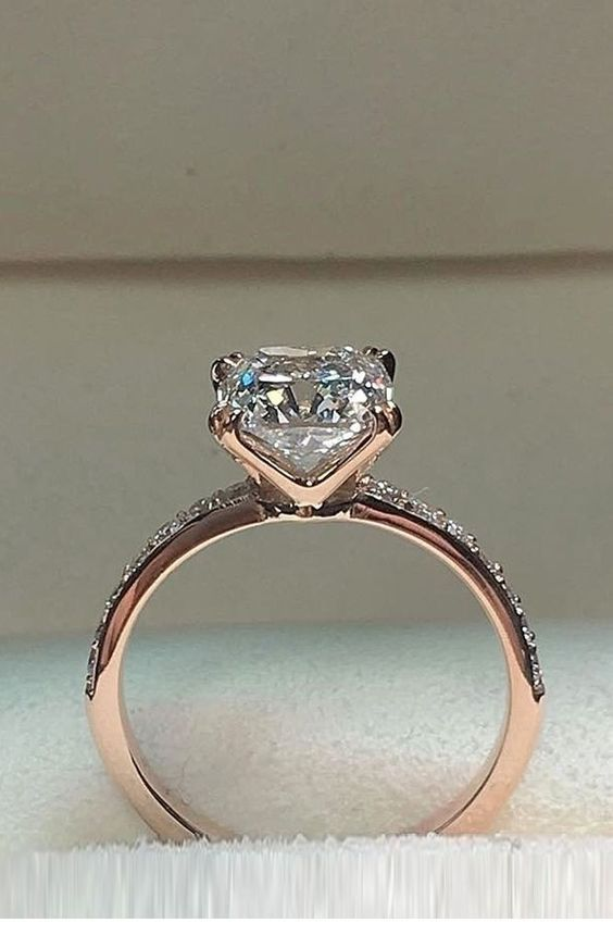 Glam rose gold engagement ring with diamond