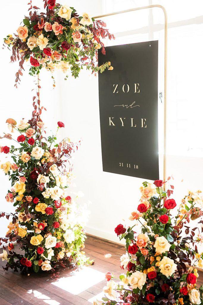 chic modern floral wedding arch ideas with black board acrylic sign
