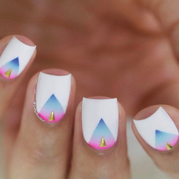 Pastel tones of pink and blue color can greatly enrich a simple manicure like white.