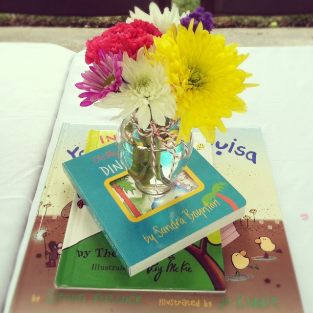 Our center piece on each table was a cake stand with a Build storybook