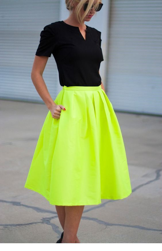 Black top and neon skirt