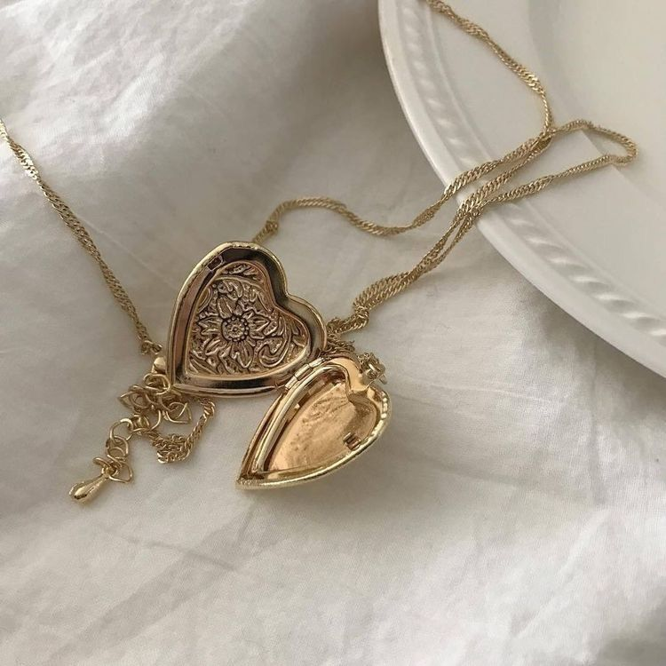 Small golden heart locket necklace