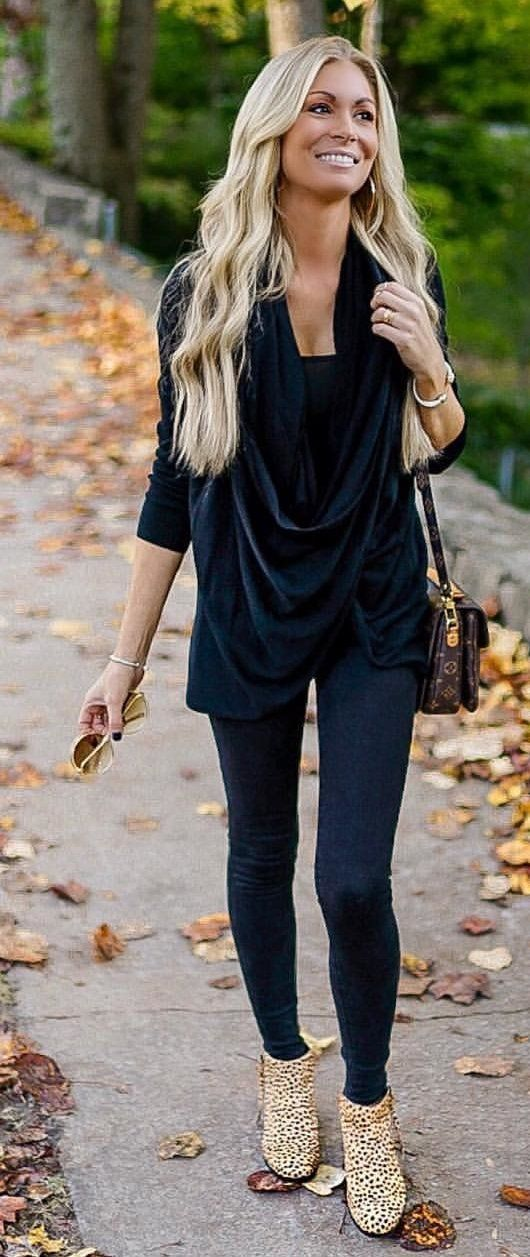 black cowl-neck top and black leggings
