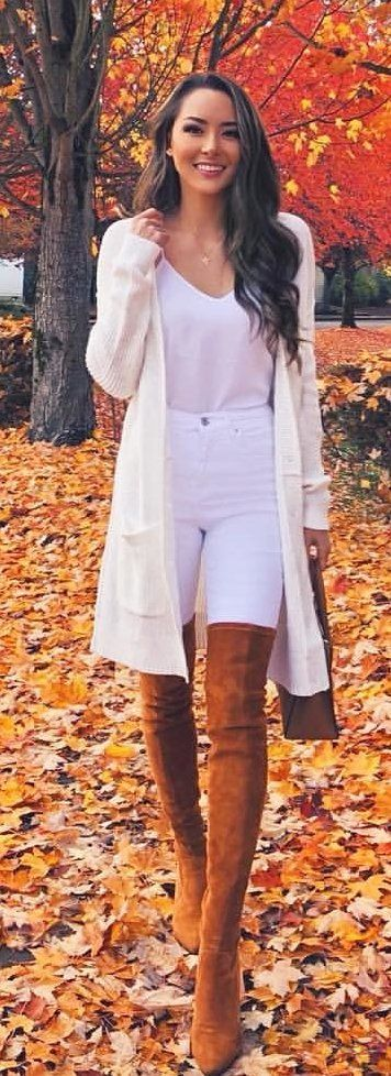 white cardigan and pair of brown suede boots