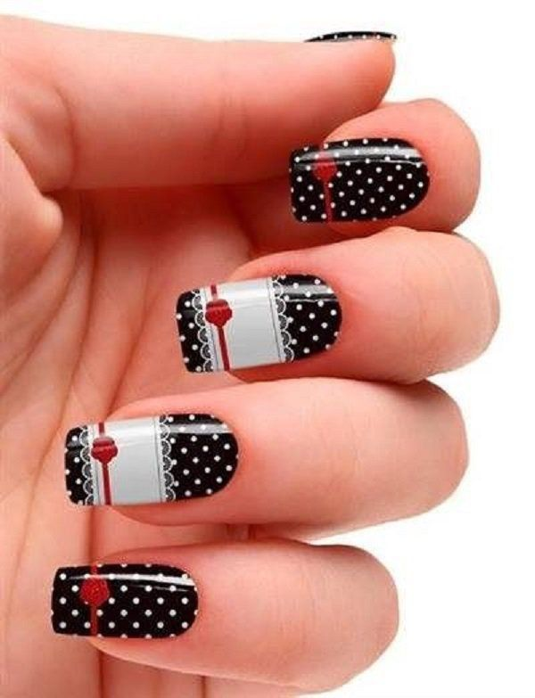 Black, white and red lace and polka dot winter nail art design. A perfect combination of designs and colors that make your nails look absolutely stunning.