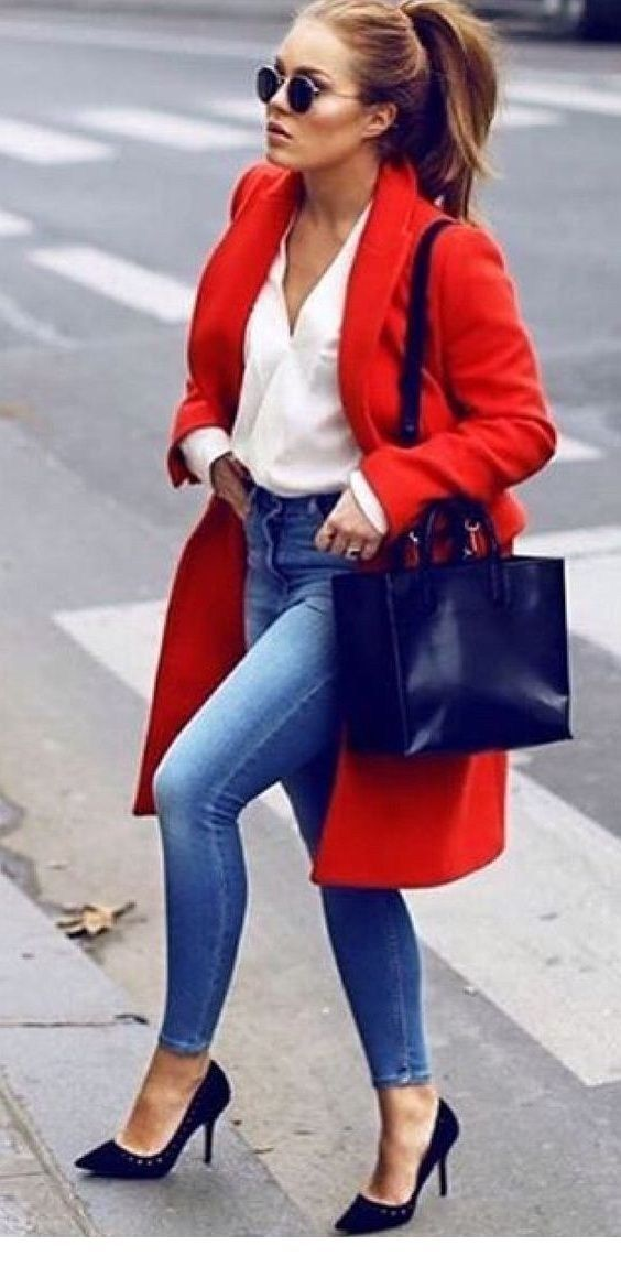 White shirt, blue jeans and red coat