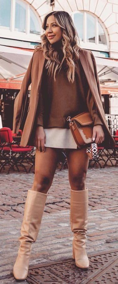 brown sweater and white skirt