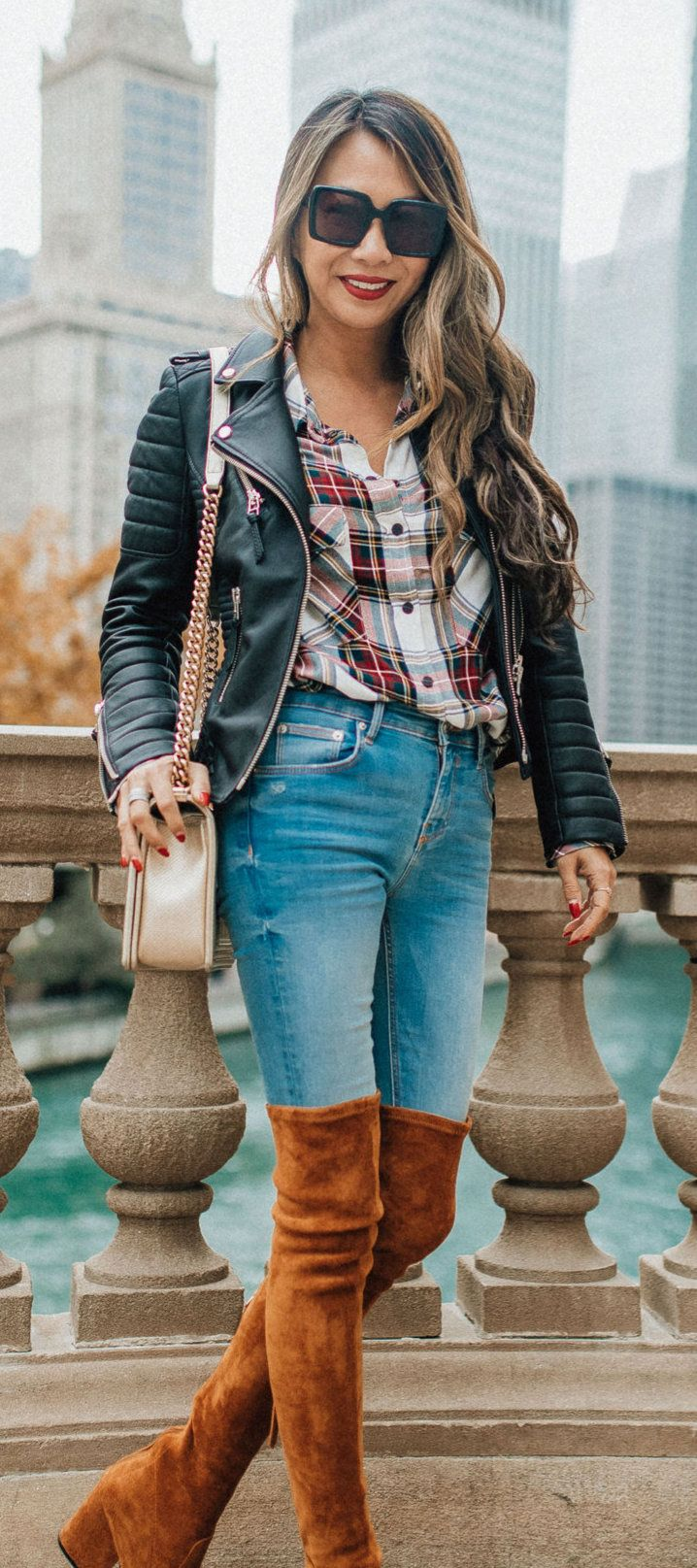 black leather jacket and blue denim fitted jeans