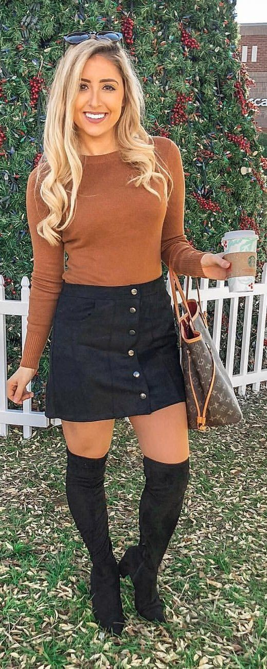 brown sweater and black skirt