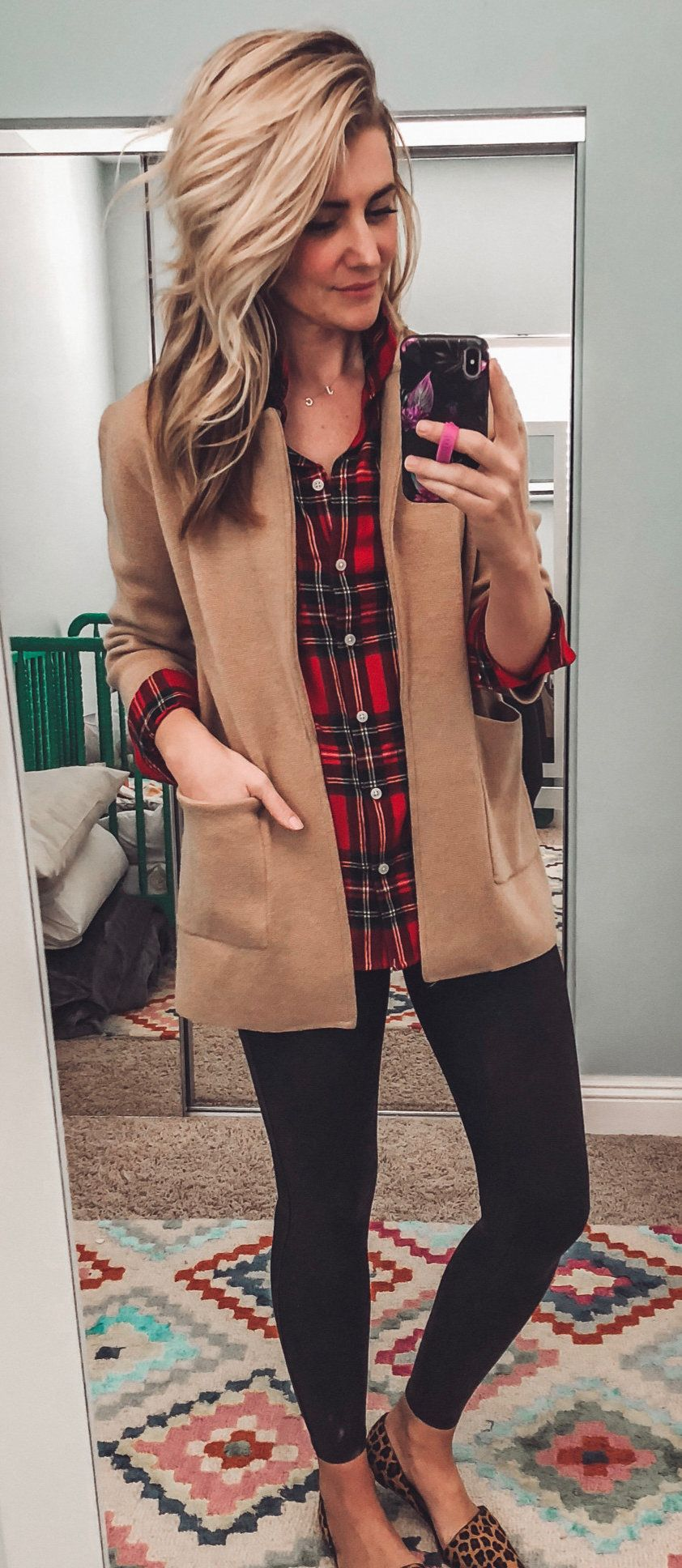 red-and-black plaid button-up shirt and brown coat