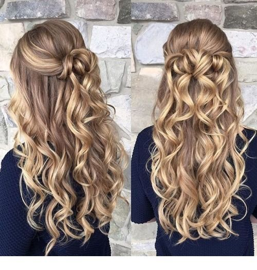 Amazing long blonde curls and navy top