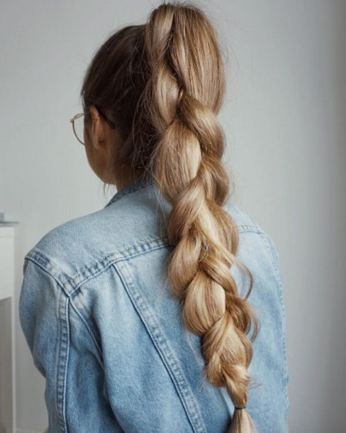 Large braided ponytail by Amelie Cheval