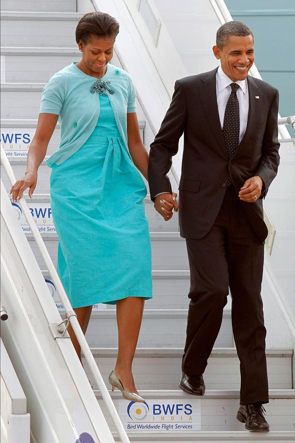 The First Lady wore a custom-made dress by Peter Som to arrive in New Delhi, India, the second stop on her three-day visit to the world's largest democracy with husband Barack.