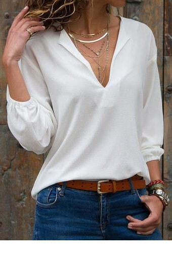 Nice white simple blouse and blue jeans