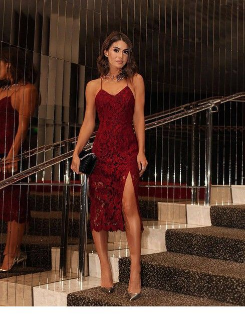 Glam red lace dress with silver pumps and black bag