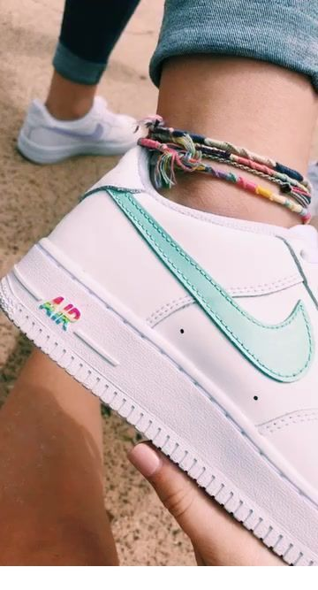 White sport shoes with mint detail