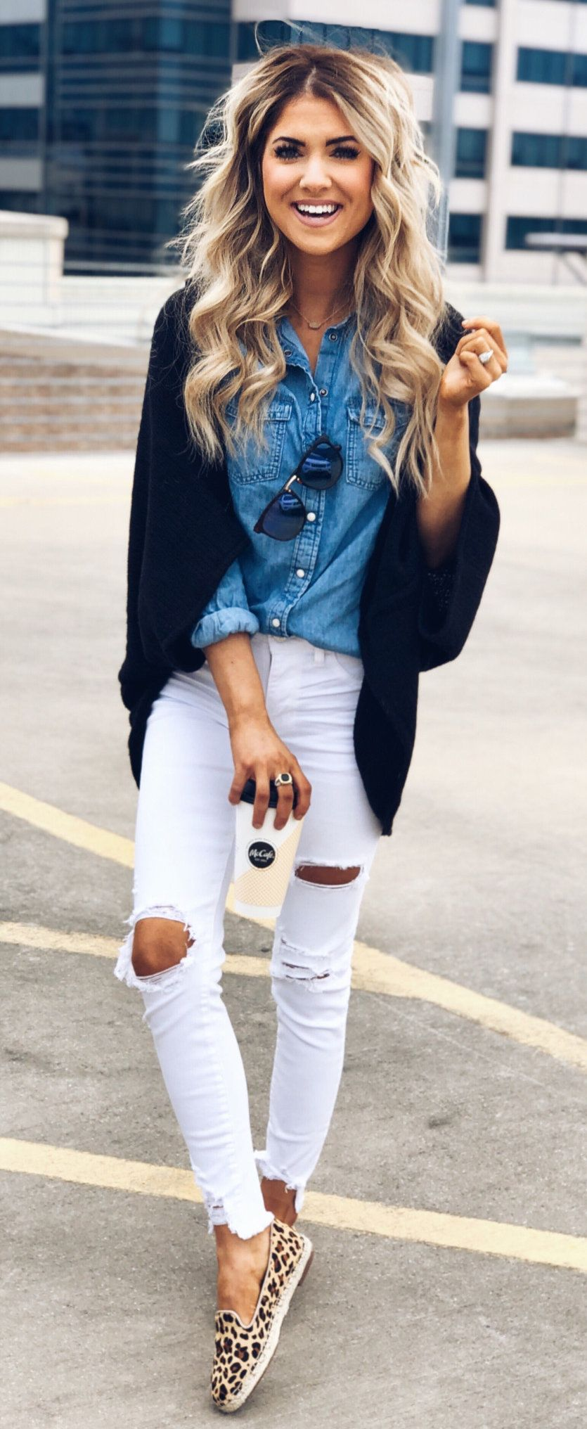 blue denim button-up shirt, black open cardigan, and white distressed jeans #spring #outfits