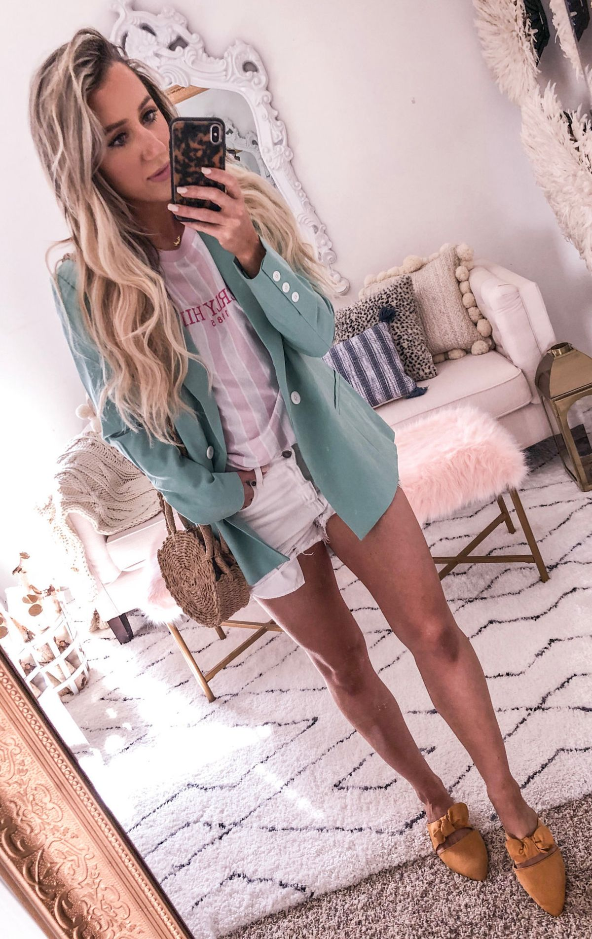 green long-sleeved cardigan, white shirt, and denim short shorts #spring #outfits