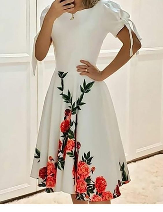 Simple white dress with some red flowers