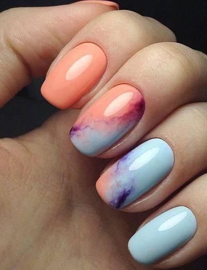 Sublime nail art design with light blue orange and purple colors