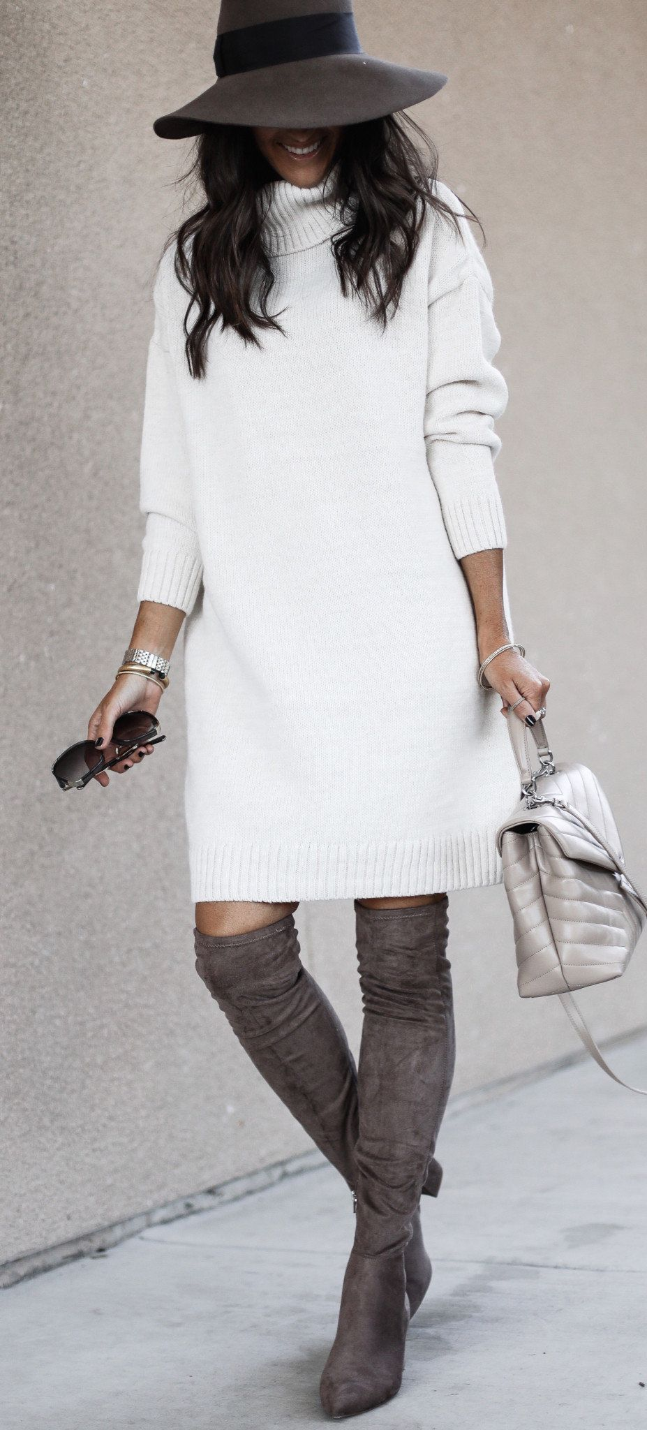 white long-sleeved dress and black hat