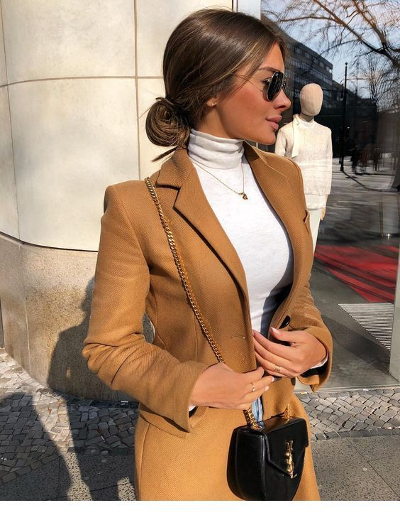 White blouse and brown coat with a black bag