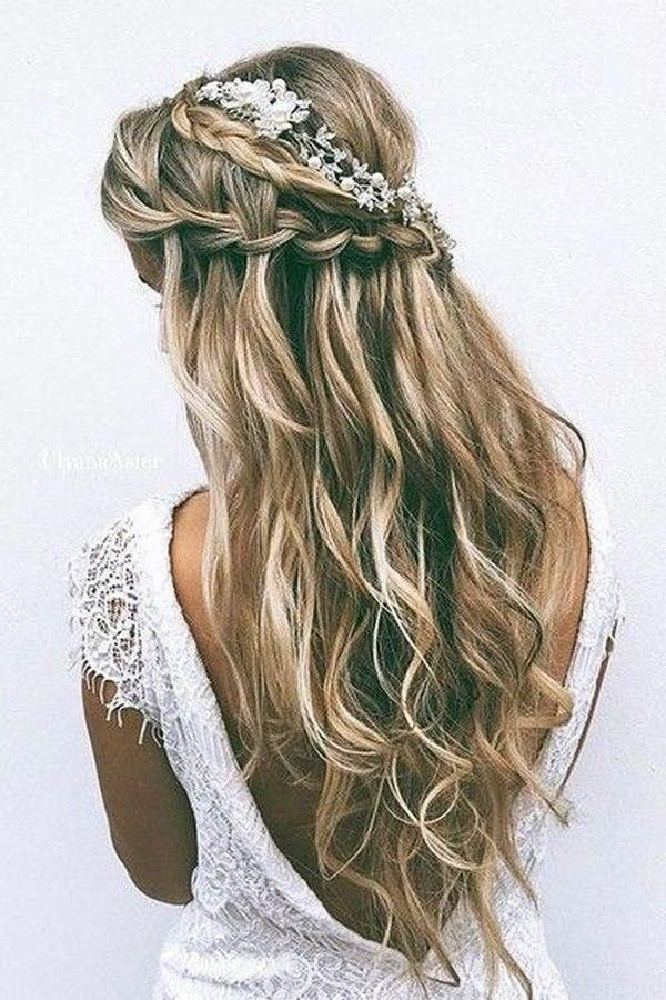 romantic half up half down wedding hairstyle with braids and baby's breath
