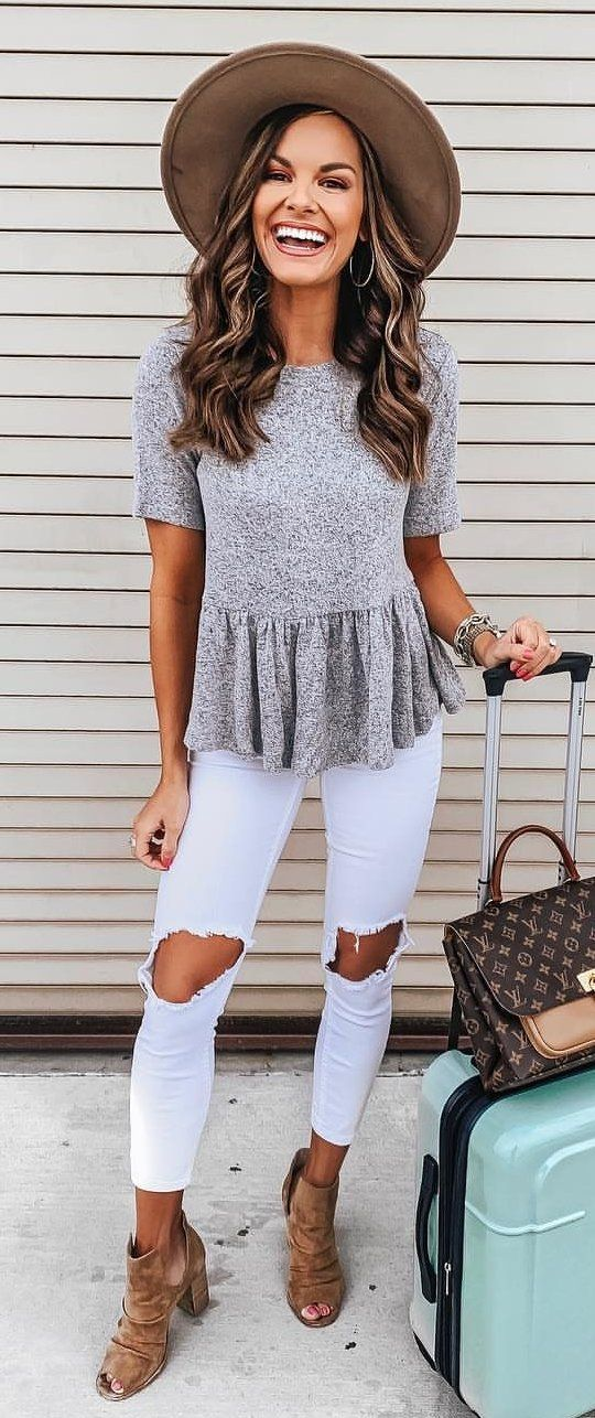gray short=sleeved peplum top, white distressed pants, and brown leather strappy heeled sandals #spring #outfits