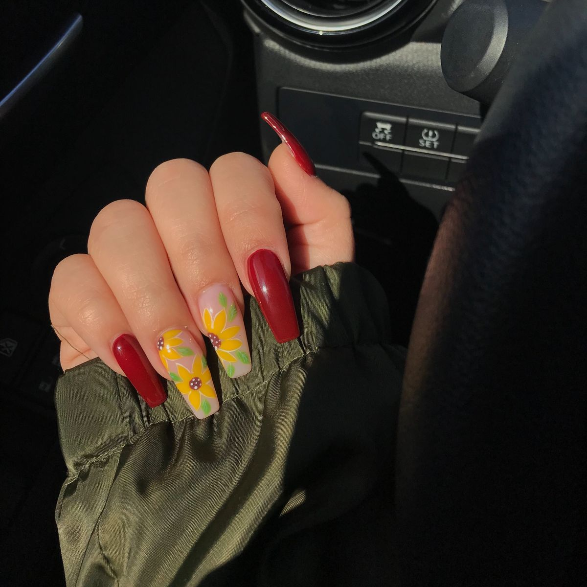 Sunflowers and red acrylic coffin nails