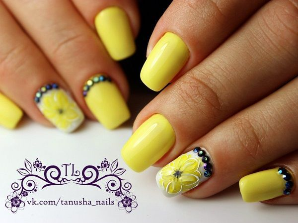 Beautiful Flower Inspired Yellow and White Nail Art Design. Turn your nails into the summer colors with this amazing and beautifully done yellow nail art design. Add your stuff like rhinestones and 3D flowers to make the look elegant-er.