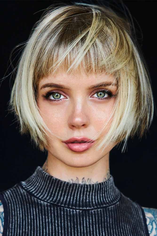 Shaggy Bob With Trimmed Front Bangs #shaggyhairstyles #blondehair #bangs ★  Short hairstyles for round faces are in trend! If you have blonde hair and a round face, check out these 40 hairstyle ideas. #glaminati #lifestyle #shorthairstylesforroundfaces