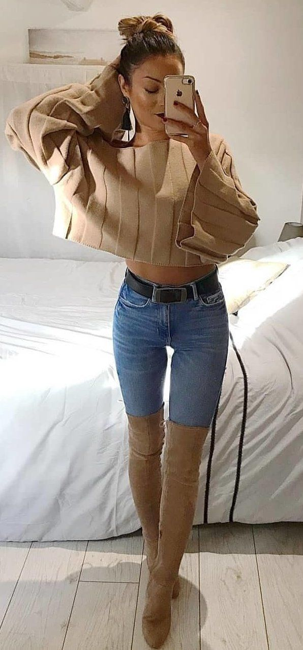 brown long-sleeved crop top and blue denim jeans #spring #outfits