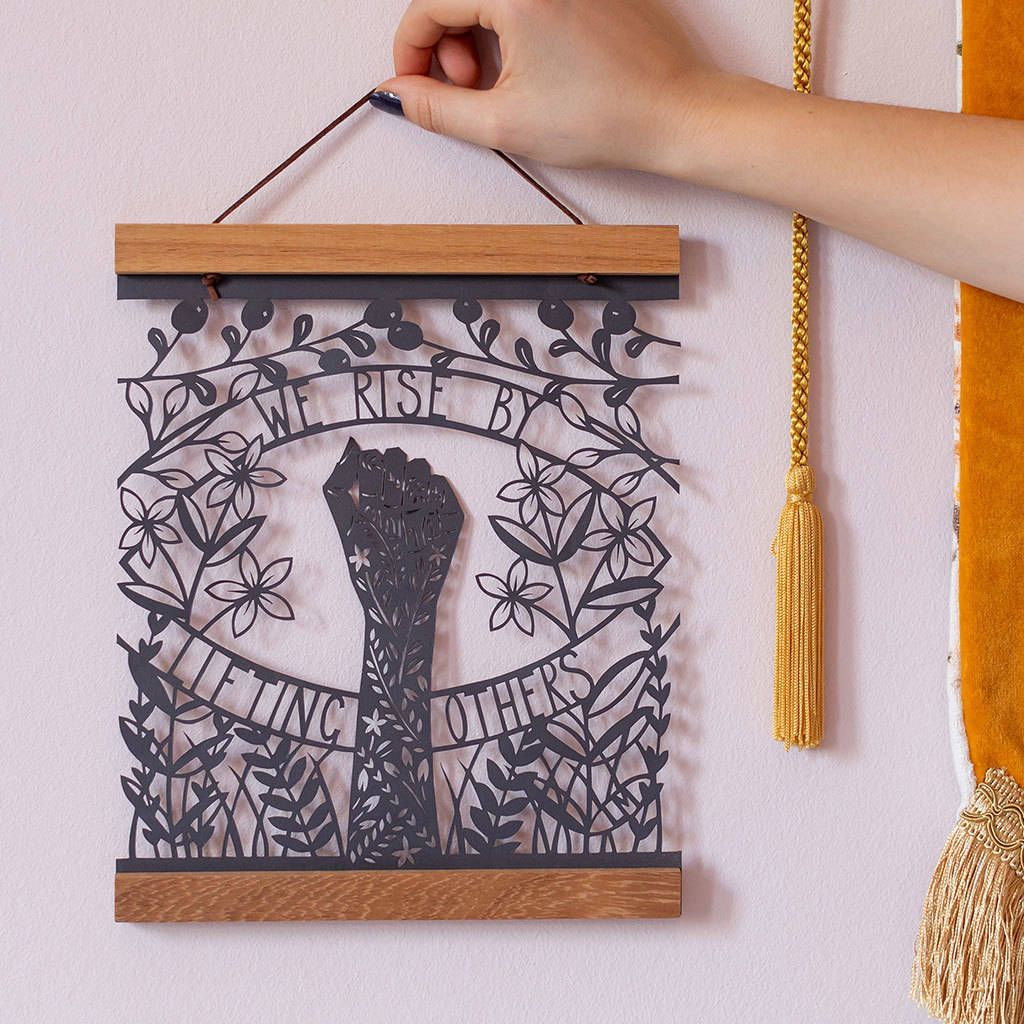 'We Rise By Lifting Others' Papercut