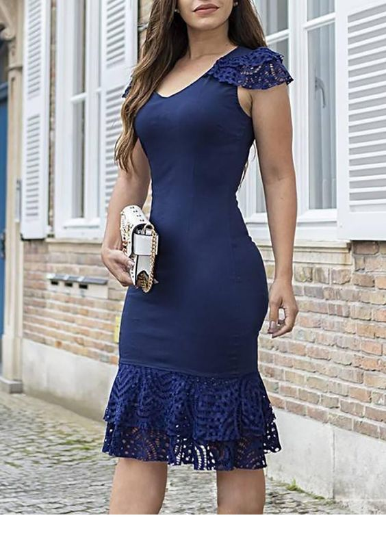 Very cute navy dress with lace and ruffles