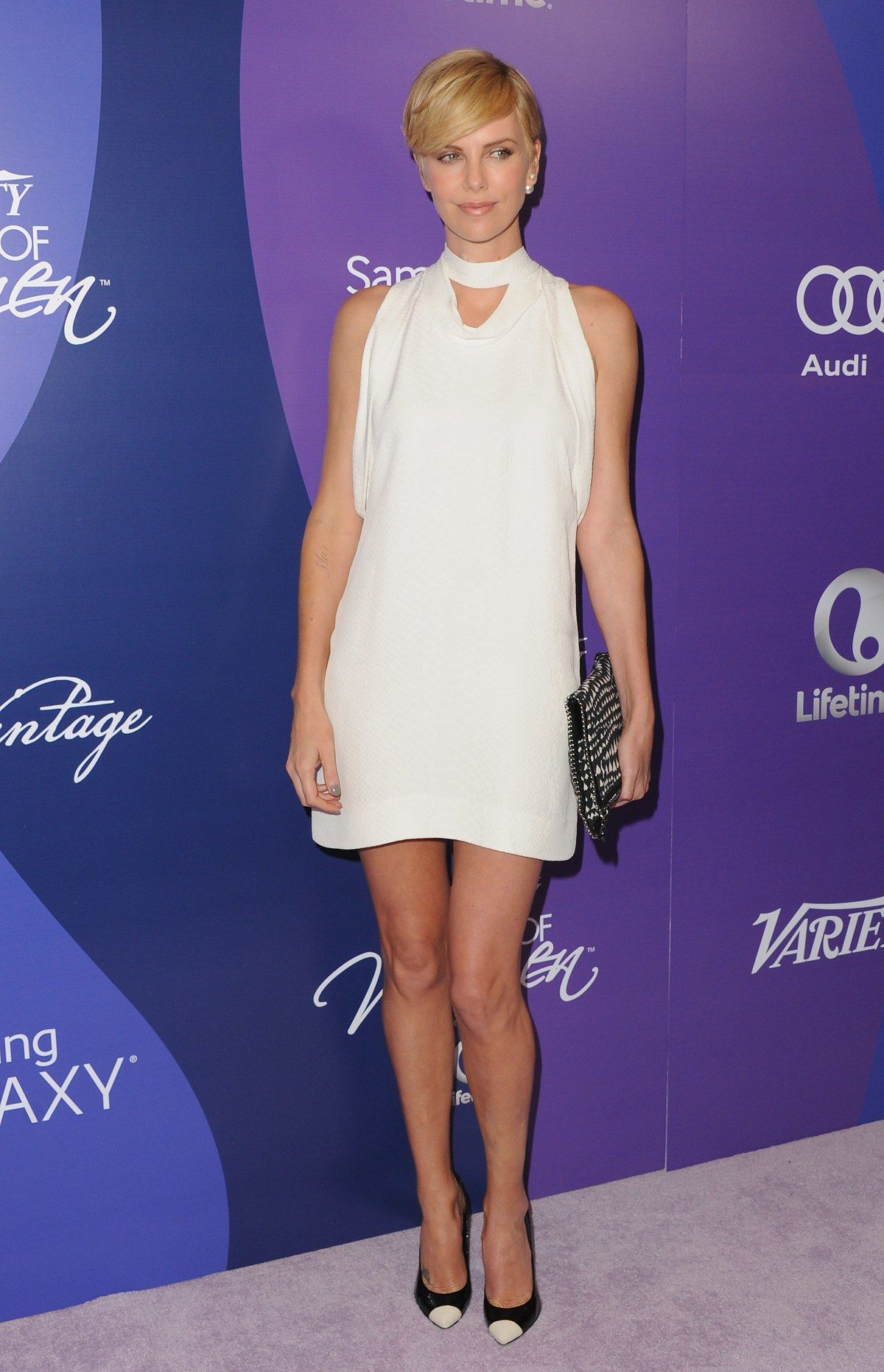 Charlize Theron in Stella McCartney at the 5th annual Variety Power of Women party in Beverly Hills, California, October 2013. Photo by Getty Images.
