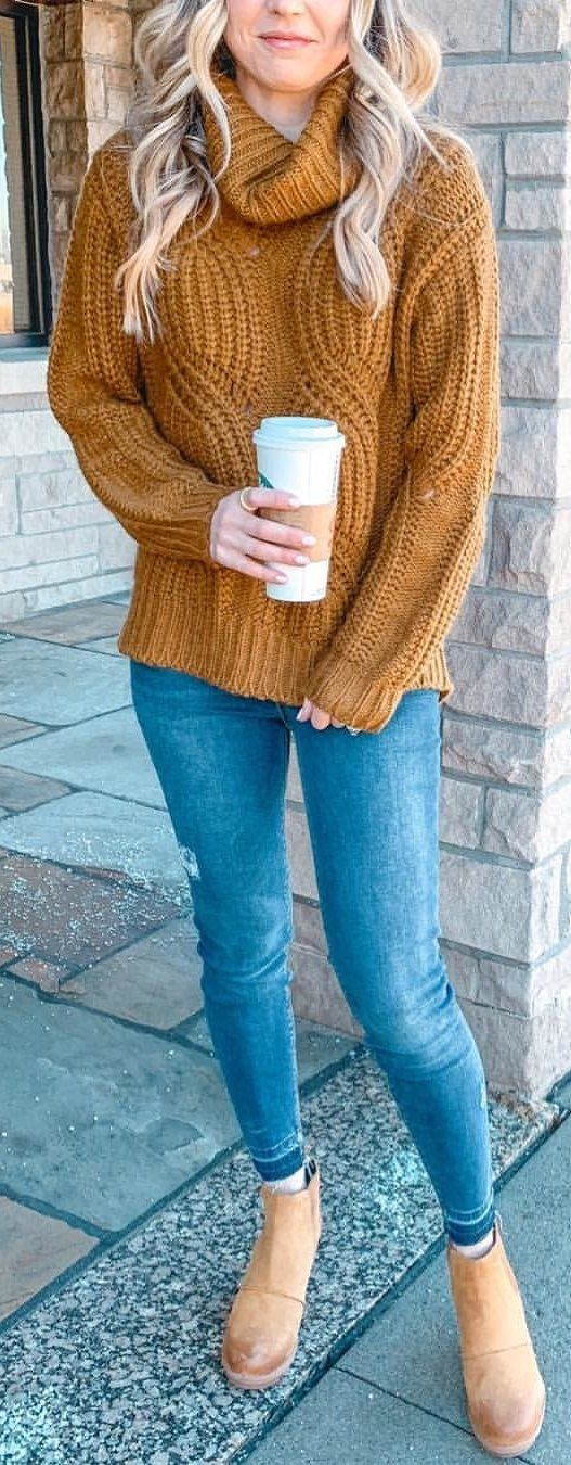 brown knit sweater and blue jeans