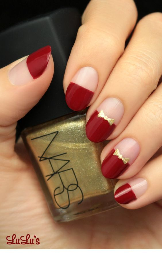 Glam burgundy nails and gold details