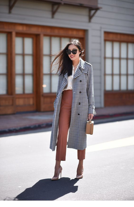 White shirt, brown pants and plaid coat