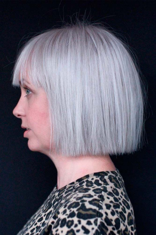 Chin-Length Bob With Straight Bang #greyhair #sleekhairstyles ★ Short haircuts for women over 50 are special due to their ability to revive the image of a woman and to make her appear years younger. 50 is not the end of the world, trust us. In this post, you can explore the cuts that will enhance your features and cut off some years. Ready? #glaminati #lifestyle #shorthaircutsforwomenover50