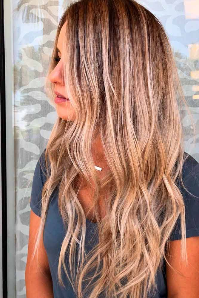 Long Layered Hair With Wavy Ends #wavyhairstyles #blondehighlightshair ★ Explore trendy long haircuts with layers for women. We have ideas for wavy, straight, thin and for thick hair. #glaminati #lifestyle #longhaircuts