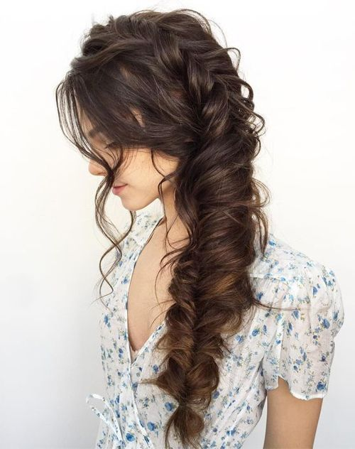 Precious fishtail braid on dark brown long hair