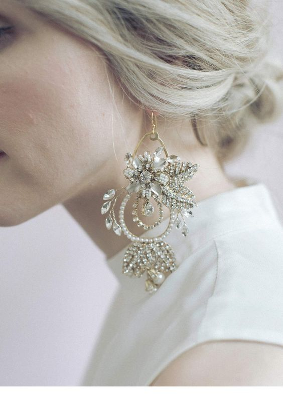Glam big earring design and a white dress