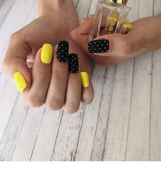 Yellow nails with polka dots