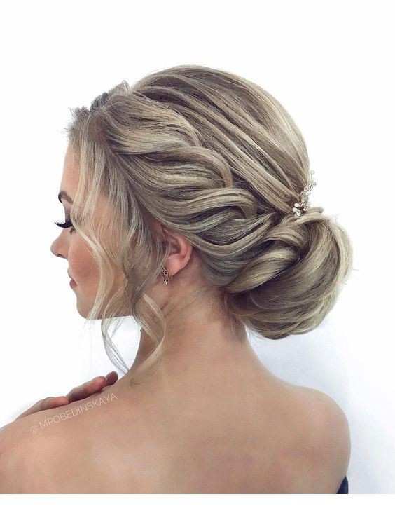 Glam side braid style and a low bun