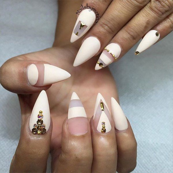 Cone shaped nails may look dangerous but you can make it look sophisticated by creating shapes (by not painting certain parts) and adding diamonds and gold beads.