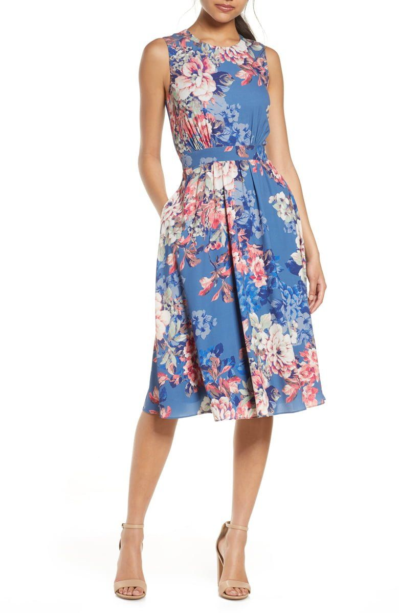 Wistful florals impart a touch of sweet romanticism to this fit-and-flare sundress designed with convenient side pockets.