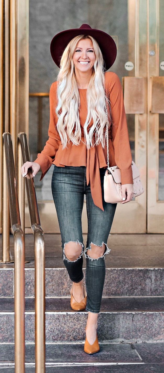 orange long-sleeved shirt and black jeans